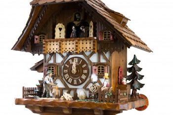 8-day Black Forest house cuckoo clock with spinning wheel, music and dancers