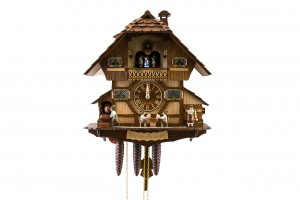 1-day Black Forrest house with two beer drinkers, barrel-wheel, music and dancers
