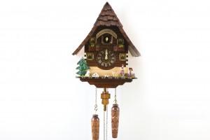 Quartz Black Forest Chalet cuckoo clock with Black Forest Girl and St. Bernard