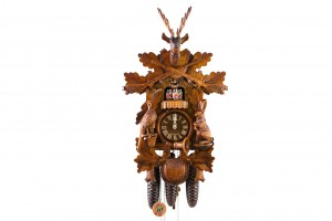 8-day carved cuckoo clock with dear, rabbit, pheasant music and dancers